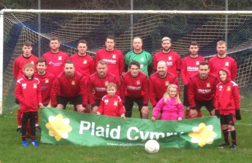 Plaid Cymru sponsorship banner held by first team.